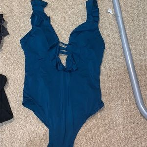 Turquoise one piece bathing suit , only worn once